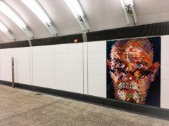 One of two Chuck Close self-portraits at the 86th Street station